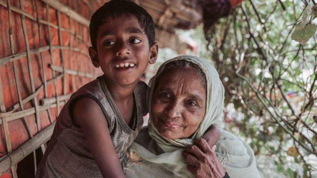 Young boy hugging older lady